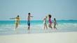 Healthy male female Caucasian family on tropical beach in swimwear