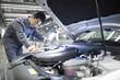 Mechanic repairing car in a workshop