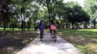 Young happy multi ethnic fitness girls cycling outdoor