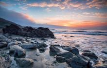 Beautiful Sunrise Over A Rocky Beach