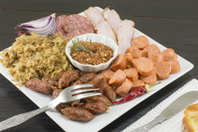 Various Types Of Meat On A Whi...