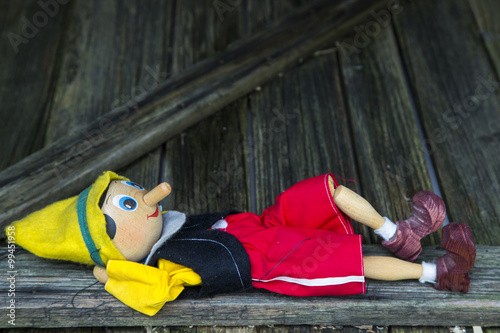 Old wooden pinocchio marionette toy . Canvas Print