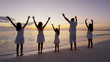 Silhouette at sunrise of a Caucasian family on vacation beach
