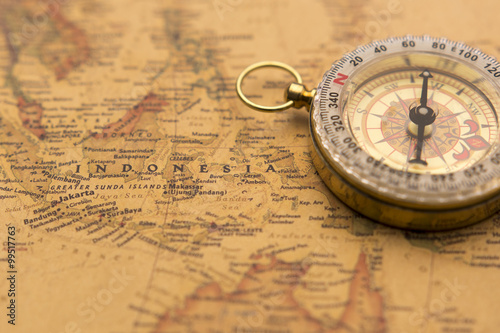 Old compass on vintage map selective focus on Indonesia Canvas Print