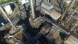Aerial shot of refinery with smoke stacks