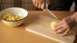 chef cutting potato on cutting bord