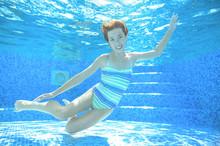 Child Swims In Pool Underwater, Happy Active Girl In Goggles Has Fun Under Water, Kid Sport