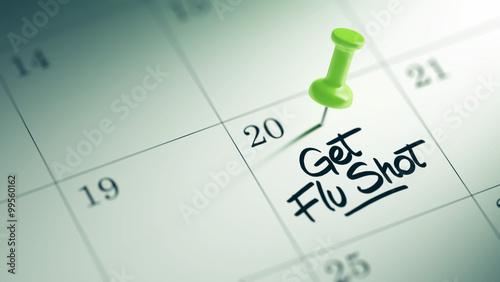 Tablou Canvas Concept image of a Calendar with a green push pin. Closeup shot