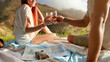 Young couple enjoying a picnic with wine.