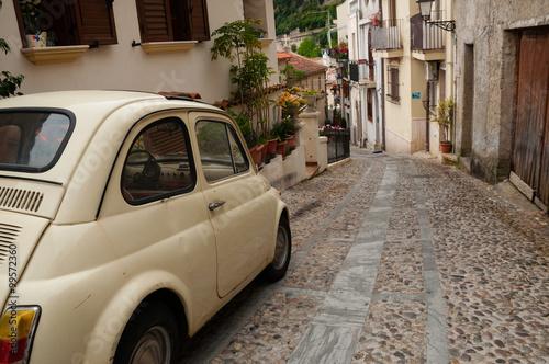 Foto auf Leinwand Schmale Gasse Small italian car on narrow road in village Scilla