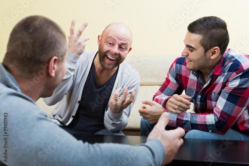 Fotografie, Tablou  Guys sitting at table