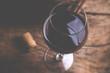 Leinwanddruck Bild - red wine glass - tilt shift selective focus effect vintage style photo