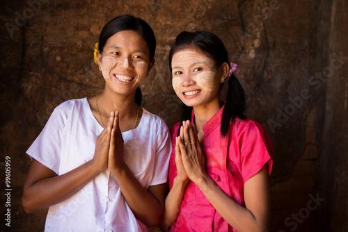 fototapeta na lodówkę Two young Myanmar girls in welcoming posture