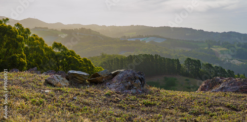 Tuinposter Heuvel Valley view from rocky top of the hill late afternoon landscape