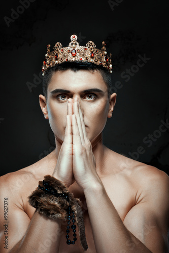 Fotografie, Obraz  Man crown on his head to pray with folded hands.