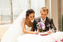 Bride Signing Marriage License...