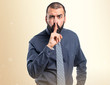 Man making silence gesture