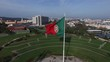 Portuguese Waving Flag on top of the Eduardo VII Park in Lisbon, Portugal