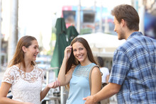 Girl With A Friend Flirting With A Boy