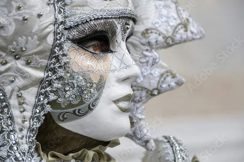Profile of masked woman