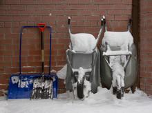 Snow Showels And Wheelbarrows In Winder Yard