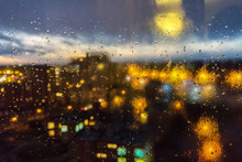 Window With Drops Of Night Rain In A City
