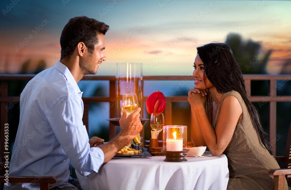 Fototapeta couple on summer evening having romantic dinner
