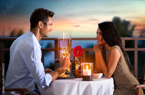 Fototapeta couple on summer evening having romantic dinner obraz
