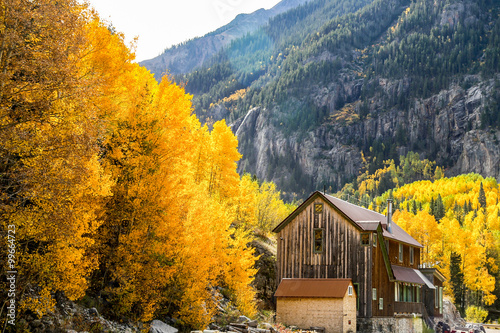 Old barn Ouray CO fall mountians leaves turning color yellow