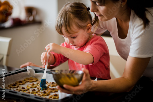 Fotografie, Obraz  Mother and child baking together