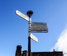 Direction Sign In Edinburgh Castle With Blue Sky, Scotland, UK