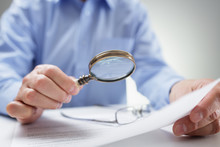 Businessman With Magnifying Gl...