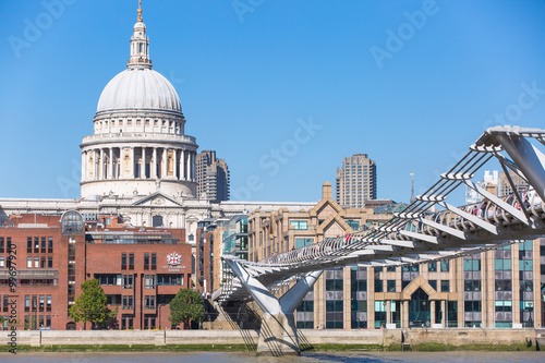 Staande foto Stockholm LONDON, UK - SEPTEMBER 10, 2015: St. Pauls cathedral and millennium bridge with people crossing the bridge