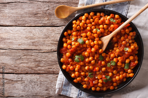 Fotografie, Obraz  Indian Food Chana masala on a table. Horizontal top view