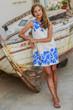 Young and beautiful girl in Oia - Santorini, Greece