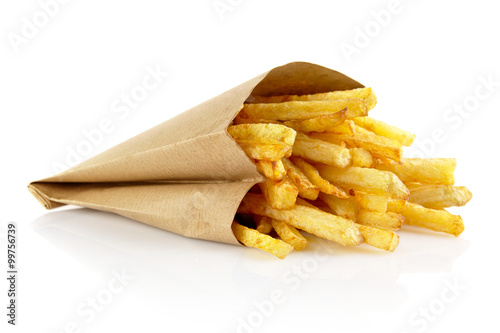 Obraz na plátne French fries in the paper bag isolated on white