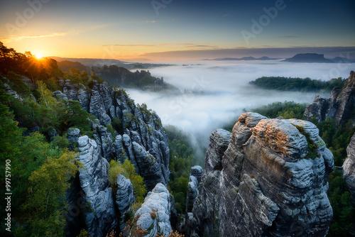 Fotografie, Obraz  Foggy sunrise at Bastei, Saxon Switzerland, Germany