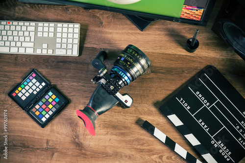 Fotografie, Obraz  Desktop top shot of a modern Cinema Camera on stylish wooden workplace