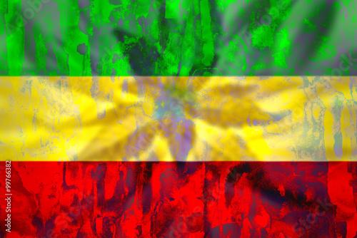 Fotografie, Obraz  Cannabis bud on grunge rastafarian flag.