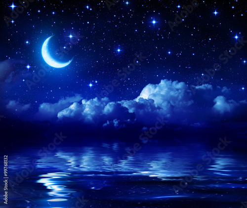 Starry Night With Crescent Moon On Sea