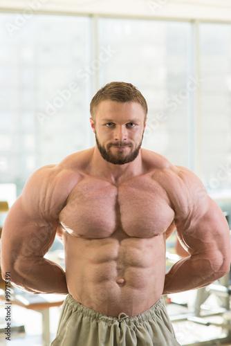 Fotografie, Obraz  Muscular bodybuilder.