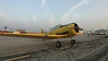 Pan Across To A Wide Angle View Of A T-6 Harvard (also Known As A Texan) Training Aircraft, Parked At Airfield.  Recorded In 4K, Ultra High Definition.