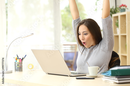 Euphoric and surprised winner winning online Fotobehang