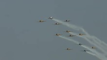 Twelve T-6 Harvard Trainers (also Known As A Texans) Flying In Formation And Leaving Smoke Trails.  Used By Canada And The United States For Pilot Training.  Recorded In 4K, Ultra High Definition.