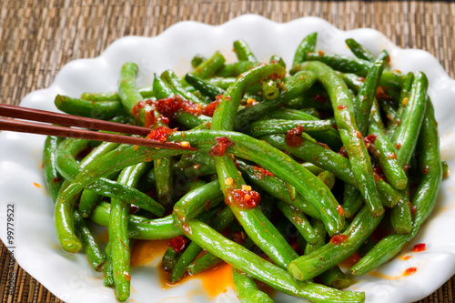 Fotografering Cooked spicy greens in plate ready to eat