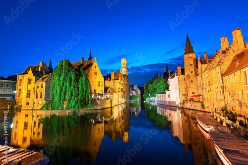 Deurstickers Brugge Dock of the Rosary (Rozenhoedkaai) at twilight, a scene from a medieval fairytale in Bruges, Belgium