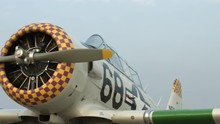 Pan Across The Front Of A T-6 Harvard (also Known As A Texan) Training Aircraft, Parked At Airfield.  Recorded In 4K, Ultra High Definition.