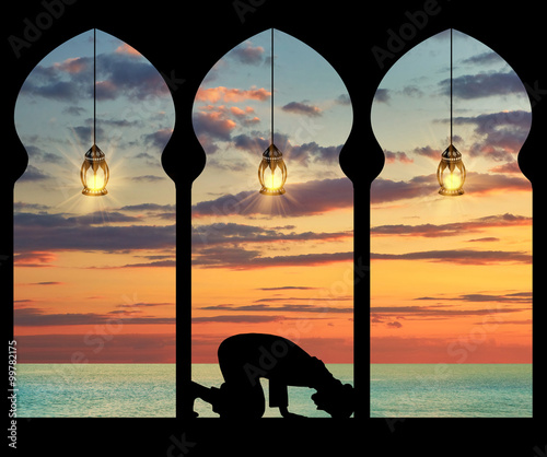 Silhouette of praying Muslim