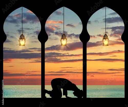 Silhouette of praying Muslim
