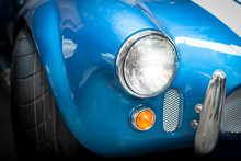 Headlight Detail Of Blue Classic Car
